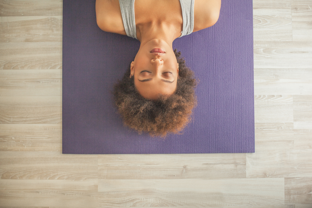 stress relieving exercise on a mat