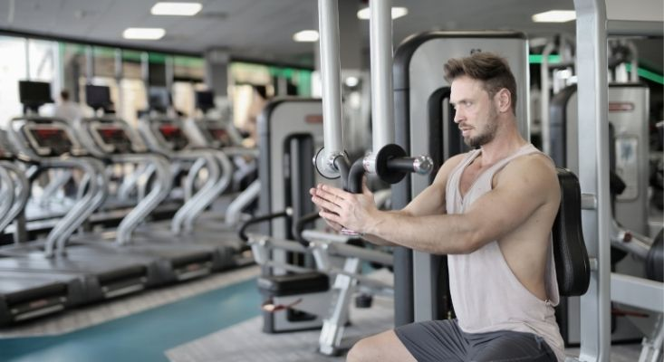 build your pecs with pectoral fly machine